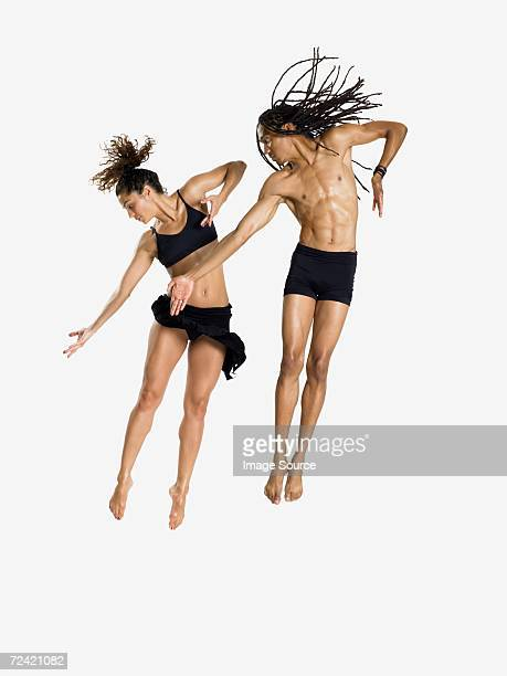 dancers jumping - modern dancing stock pictures, royalty-free photos & images