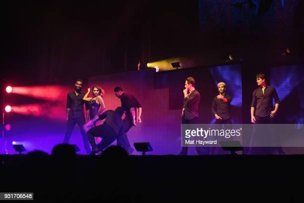 Dancers Keo Motsepe Jenna Johnson Alan Bersten Sasha Farber Jordan Fisher and Gleb Savchenko perform on stage during Dancing With The Stars Live at...