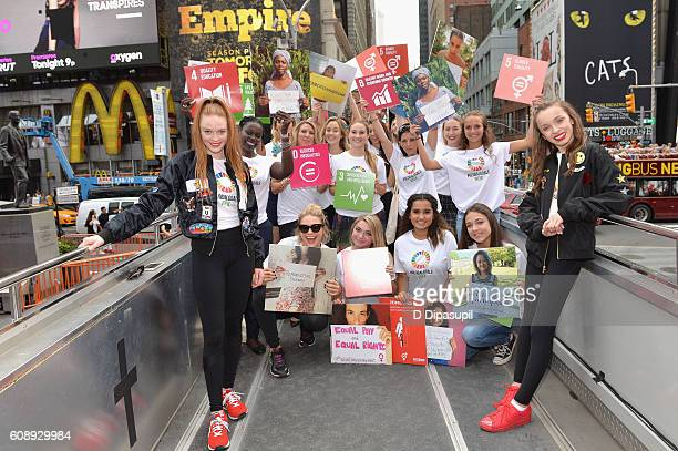 Dancers Larsen Thompson and Taylor Hatala pose with goals signs on top of the 2016 Global Goals Girls Bus in Times Square on September 20 2016 in New...