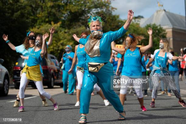 Dancers lead a march during a NHS workers pay rise protest on September 12, 2020 in Bristol, England. Nurses and NHS staff are protesting after being...