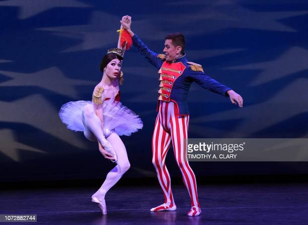 """Dancers Long Zou and Giovanni Ravelo from Les Ballets Trockadero de Monte Carlo perform a scence from """"Stars & Stripes Forever"""" during a dress..."""