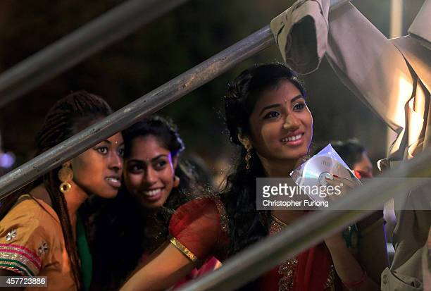Dancers look on from backstage as they wait their turn to entertain people celebrating the Hindu festival of Diwali on October 23 2014 in Leicester...