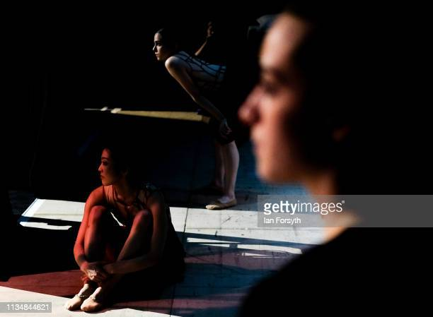Dancers look on from the wings as they wait to enter the stage during the World Premier of Northern Ballet's performance of 'Victoria' at Leeds Grand...