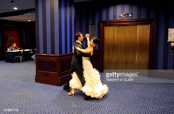 Dancers Luis Dettling and Diane Dale from Edmonton, Alberta, Canada pratice in the lobby before they compete in the Closed Smooth Category during the...