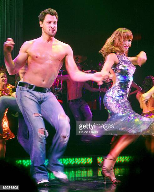 Dancers Maksim Chmerkovskiy and fiancee Karina Smirnoff perform during the curtain call on the opening night of Burn The Floor on Broadway at...