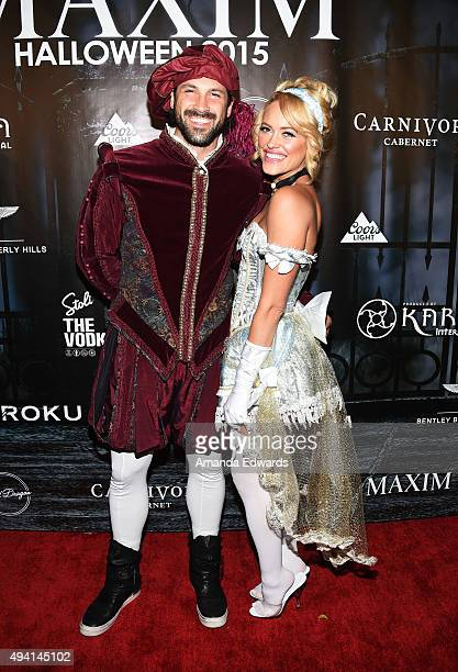 Dancers Maksim Chmerkovskiy and Peta Murgatroyd arrive at MAXIM Magazine's Official Halloween Party at a private estate on October 24 2015 in Beverly...
