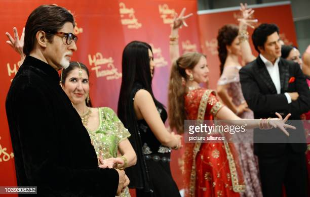 Dancers of a Bollywood dance group present the wax figures of Bollywood stars Amitabh Bachchan Kareena Kapoor Aishwarya Rai und Shah Rukh Khan at the...