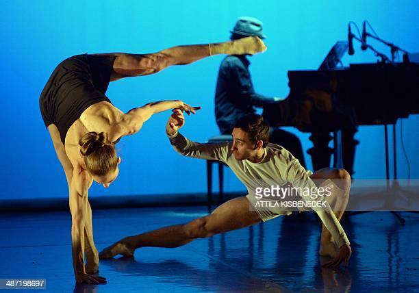 Dancers of a Hungarian contemporary group the 'PREvolution Dance Company perform on stage of the National Dance Theatre in Budapest on April 28 2014...