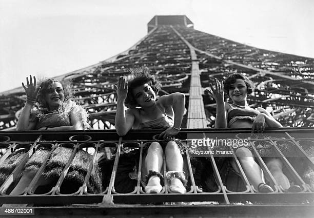 Dancers of famous Paris cabaret Moulin Rouge at the Eiffel Tower in September 1929 in Paris, France.