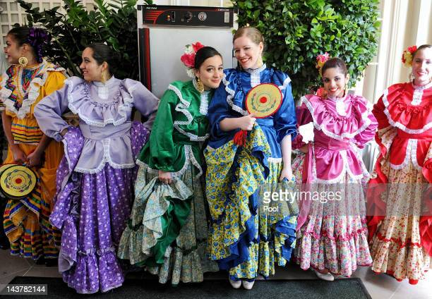 Dancers of the Ballet Folklorico Mexicano wait to perform during a Cinco de Mayo reception in the Rose Garden at the White House on May 3, 2012 in...