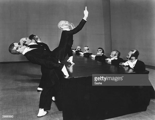 Dancers of the Ballet Jooss Leeder performing the conference scene in a production of 'The Green Table' at the Old Vic London