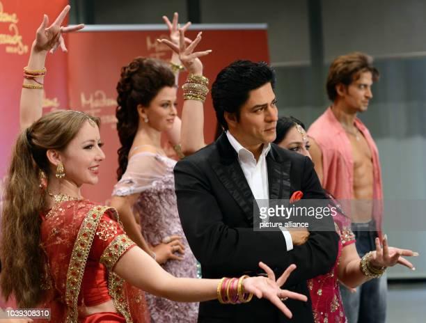 Dancers of the Bollywood dance group 'Rang De by Zaraa Vi' present the wax figures of Bollywood stars Aishwarya Rai Shah Rukh Khan and Hrithik Roshan...