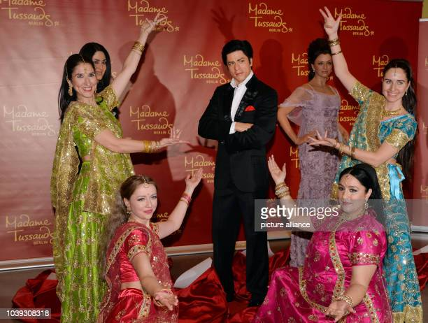 Dancers of the Bollywood dance group 'Rang De by Zaraa Vi' present the wax figures of Bollywood stars Shah Rukh Khan and Aishwarya Rai at the Indian...