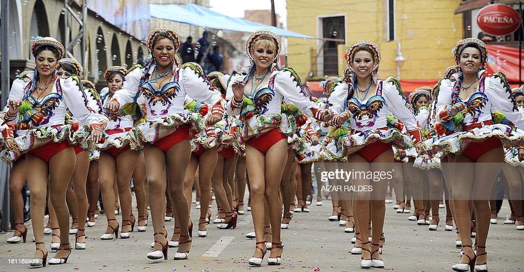 Dancers of the Caporales San Simon brotherhood preform during the Carnival of Oruro, in the mining town of Oruro, 240 km south of La Paz on February 9, 2013. The Carnival of Oruro was inscribed by UNESCO on the Representative List of the Intangible Cultural Heritage of Humanity in 2008.