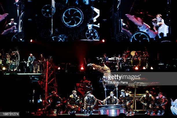 Dancers of the company 'Cirque du Soleil' dance in the show 'Michael Jackson Immortal World Tour' at Madrid Sports Palace on December 26 2012 in...
