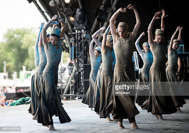 Dancers of the English National Ballet perform 'Dust', choreographed by Akram Khan, from 'Lest We Forget' on the Pyramid Stage, on the last day of...