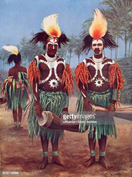 Dancers of the Fly River Region Papua New Guinea Oceania in typical traditional costume After a 19th century illustration From Customs of The World...