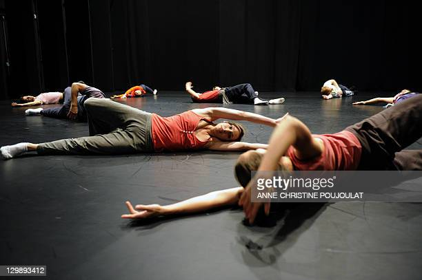 Dancers of the Geneva's Great Theatre warm up on October 21 2011 at the Maison pour la danse Klap in Marseille southern France The venue will be home...