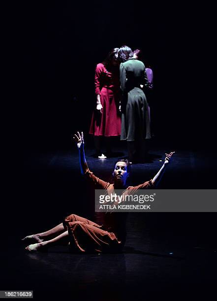 Dancers of the 'Inversedance' contemporary group perform on the stage of the National Dance Theater in Budapest on October 29 2013 during their...