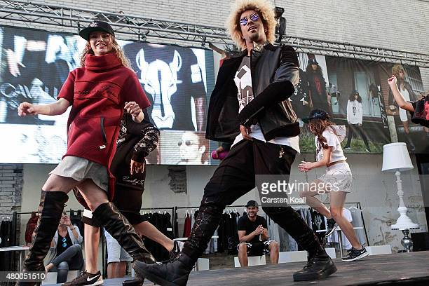 Dancers of the label BUDDHATOBUDDHA perfom on a stage during the Bread And Butter 2016 at Tempelhof Airport on July 9 2015 in Berlin Germany