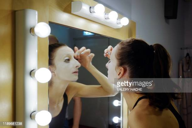 A dancers of the MonteCarlo ballet puts makeup on her face in the backstage during the rehearsal of the ballet show CoppeliA a creation by French...