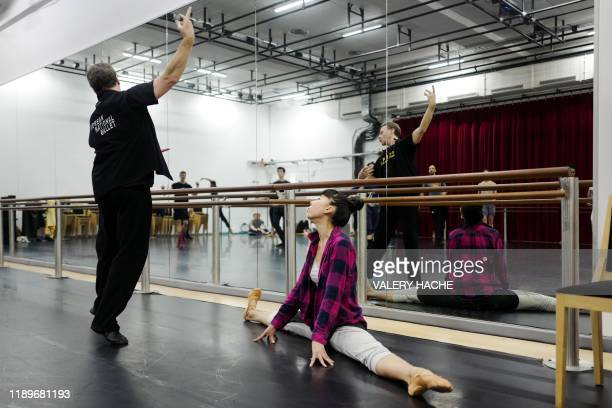 Dancers of the MonteCarlo ballet take part in class in the backstage during the rehearsal of the ballet show CoppeliA a creation by French dancer and...