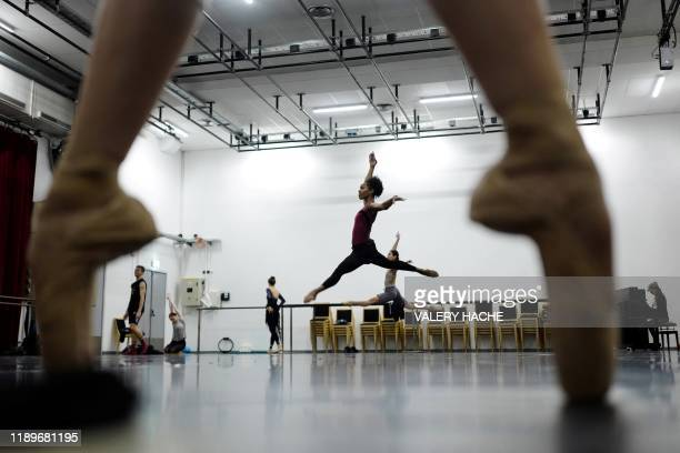 TOPSHOT Dancers of the MonteCarlo ballet warm up in a room in the backstage during a class as part of the rehearsal of the ballet show CoppeliA a...