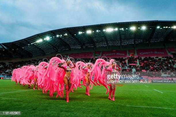 Dancers of the Moulin Rouge cabaret perform before the French Top 14 rugby union match between Stade Francais and Racing 92 on November 10 at the...