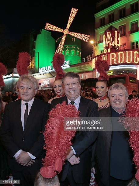 Dancers of the Moulin rouge French director of the Moulin Rouge JeanJacques Clerico Ambassador of Ireland to France Rory Montgomery and Irish...
