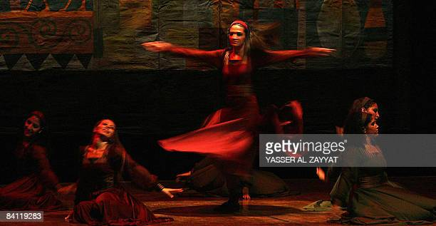 Dancers of the Palestinian Popular Arts Troupe perform during the opening of the 15th Qurain Festival in Kuwait City late on December 23 2008 The...