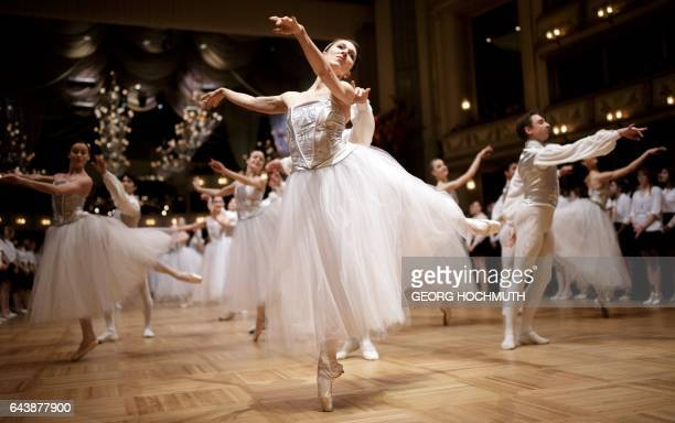 Dancers of the State Opera Ballet perform in the ballroom during the dress rehearsal for the Vienna Opera Ball at the Vienna State Opera Austria on...