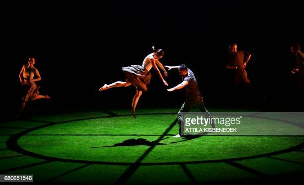 Dancers of the Szeged Contemporary Dance Company perform on the stage of Arts' Palace in Budapest on March 8 2017 during their rehearsal of Italian...
