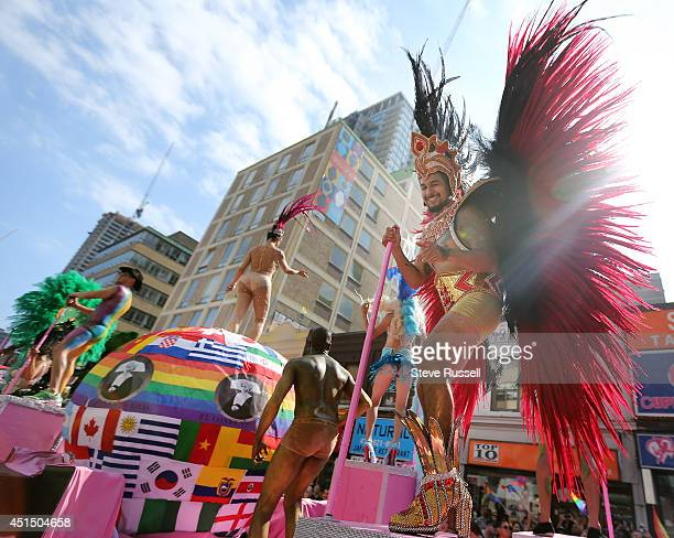 TORONTO ON JUNE 29 Dancers on a float make the turn south onto Yonge from Bloor Street during the WorldPride 2014 parade hosted by Pride Toronto...