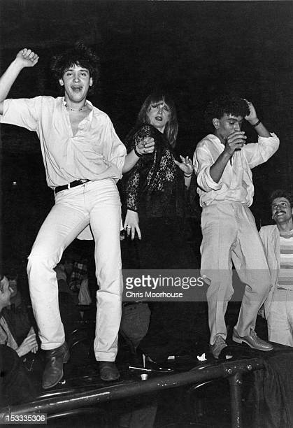 Dancers on one of the tables at the Venue London during the 'Kickers' Christmas party 11th December 1978