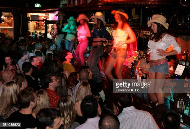 Dancers on the bar dancing during Coyote Ugly night at Patrick Molloy's an old–fashioned singles bar in Hermosa Beach