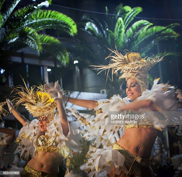 Dancers parade in the street during carnival in Santa Cruz on the Spanish Canary island of Tenerife on February 14 2015 The overmonthlong event began...