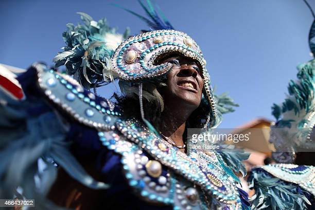 Dancers participate in a Junkanoo parade during the Calle Ocho festival in the Little Havana neighborhood on March 15 2015 in Miami Florida The...