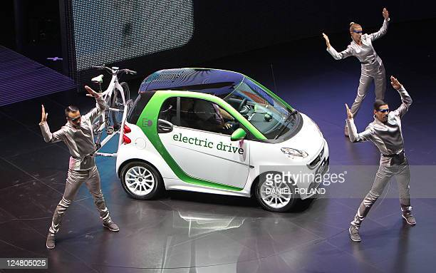 Dancers perfom during the presentation of the new esmart by German car maker Daimler AG at the international car show IAA in Frankfurt/M western...