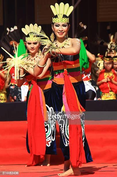 Dancers perform a Dayak dance as spectators wait for a solar total eclipse in Palangkaraya Central Kalimantan on March 9 2016 A total solar eclipse...