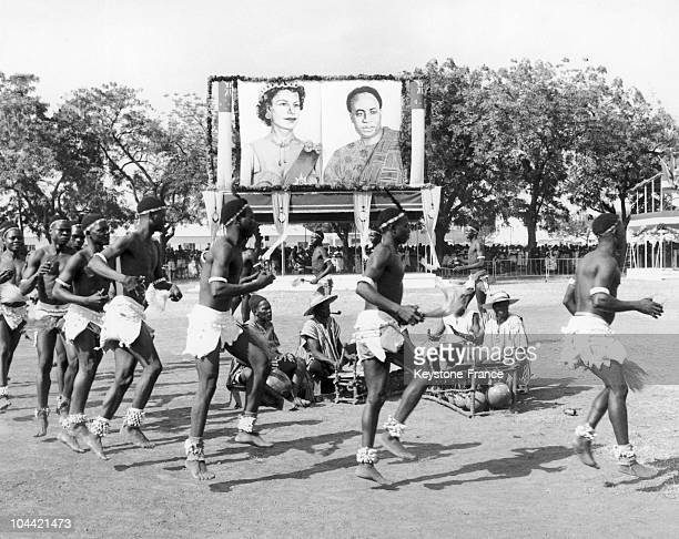 Dancers perform a performance before a portrait of Queen Elizabeth II and Kwame Nkrumah, Father of Pan Africanism, at Tamale in Ghana November 16,...