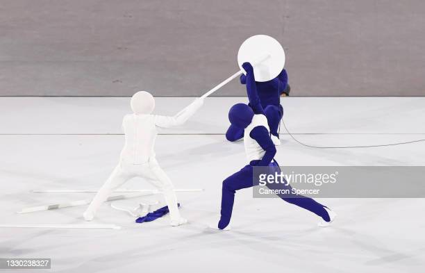 Dancers perform a pictogram of Olympic sports during the Opening Ceremony of the Tokyo 2020 Olympic Games at Olympic Stadium on July 23, 2021 in...