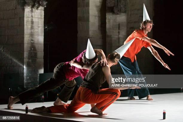 Dancers perform a scene from 'Soit le puits était profond soient ils tombaient très lentement car ils eurent le temps de regarder tout autour' by...