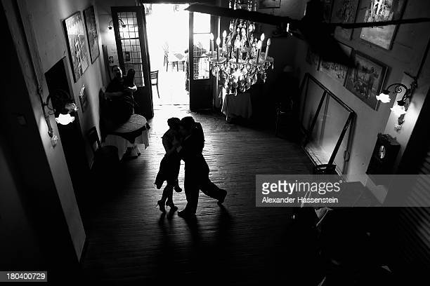 Dancers perform a Tango at La Boca on September 11 2013 in Buenos Aires Argentina