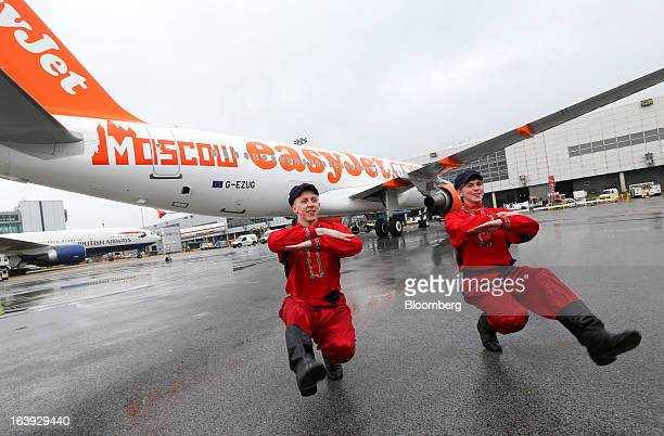 Dancers perform a traditional Cossack dance in front of an EasyJet Plc aircraft ahead of the company's inaugural flight to Domodedovo airport in...