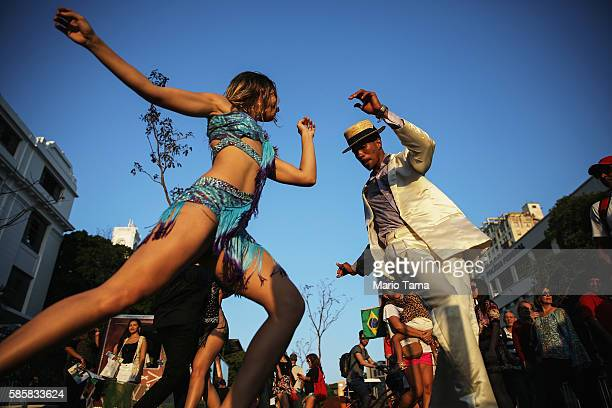 Dancers perform ahead of the arrival of the Olympic torch relay in Praca Maua on August 4 2016 in Rio de Janeiro Brazil The Rio 2016 Olympic Games...