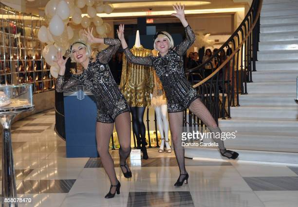 Dancers perform at a Cocktail Event in support of HOLA Heart of Los Angeles hosted by Barneys New York at Barneys New York Beverly Hills on October 5...