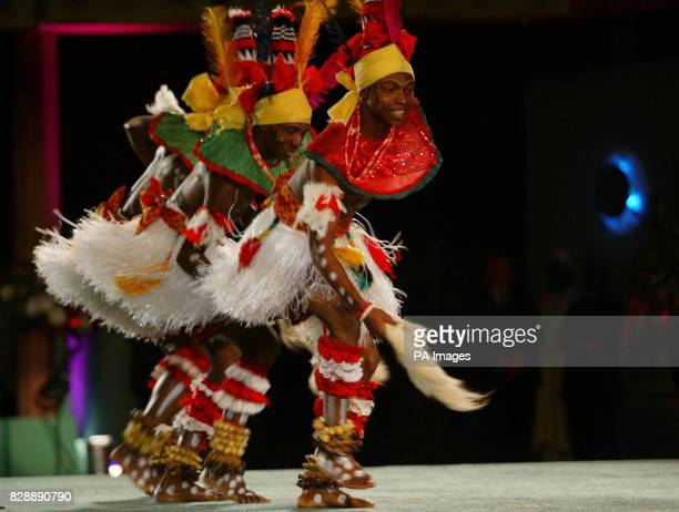 Dancers perform at the opening session of the Commonwealth Summit in Abuja Nigeria Britain's Queen Elizabeth II addressed the summit attended by...