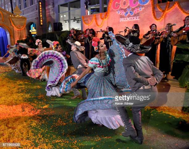Dancers perform at the premiere of Disney Pixar's 'Coco' at the El Capitan Theatre on November 8 2017 in Los Angeles California