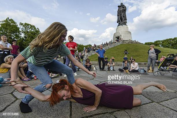 Dancers perform at the Soviet War Memorial Treptower Park in Berlin on June 27 2014 during the event '20 Dancers for the XX Century' developed by...