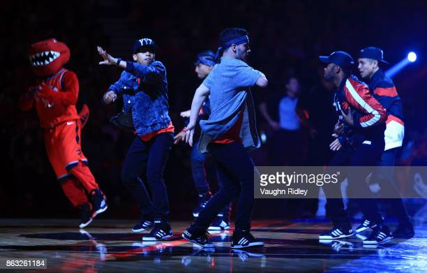 Dancers perform during a break in play of an NBA game between the Toronto Raptors and the Chicago Bulls at Air Canada Centre on October 19 2017 in...